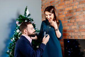 man proposes at karaoke event